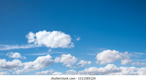 sky background with cumulus clouds in the lower half and blue sky above