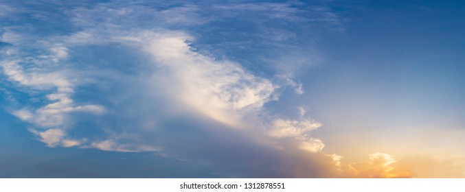 SKy background. Soft cluds in blue sky at a twilight time.