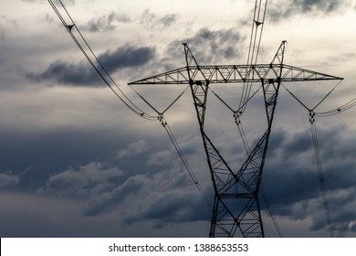 sky based shot of a power distribution tower with dark clouds in the background