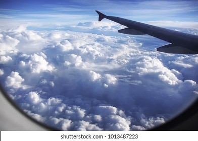 Sky with beautiful  clouds from window of airplane.The sky under the wing of the airplane. Sky background