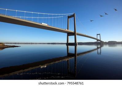 Sky blue suspension bridge over Little Belt in Denmark. Connecting Funen and Jutland.