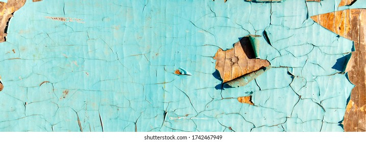 Sky blue texture of natural old wood. Background with cracks and scratches on the old painted wood blue. Used for furniture production, design and laminate manufacturing.