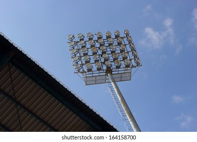 Sky and the bright lights on the football field.