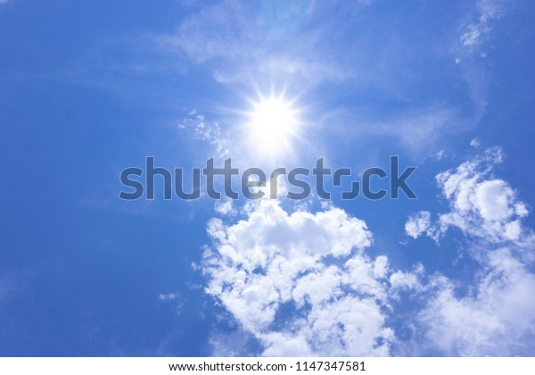 The sky is bright sun shines beautifu blue clouds with copy space for your text.