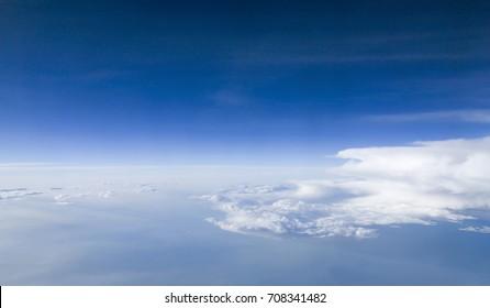 Sky and cloud as seen through window of an aircraft