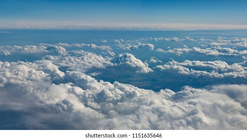 Sky and clouds above the ocean. Aerial view of the sky photographed from an airplane.