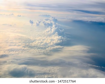 Sky with clouds from aircraft window.
