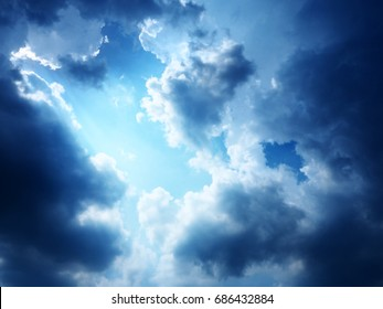 The sky and clouds are blurred, used as an abstract background.
