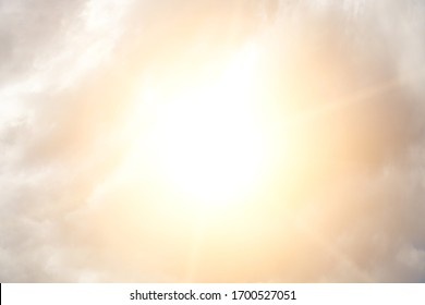 Sky with clouds and bright sun - Shutterstock ID 1700527051