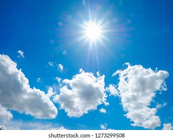 The sky and clouds and the light of the sun