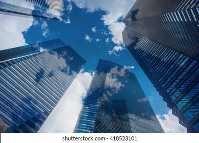 Sky and clouds reflection in skyscrappers