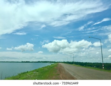 Sky and clouds with road on the dam
