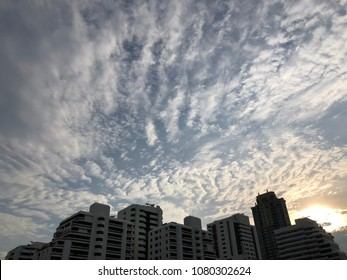 Sky with clouds and silhouette buildings