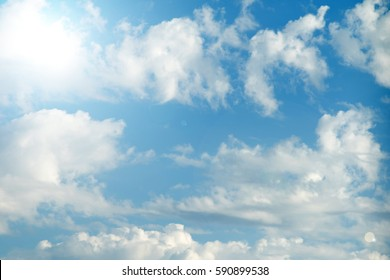 sky with clouds and sun