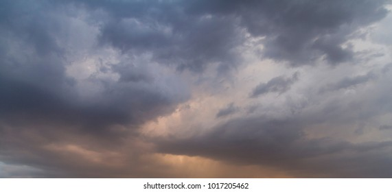 Sky with clouds and sunlight at sunset. colorful and cheerful, wallpaper or texture