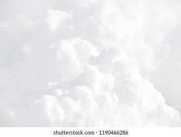 Sky with clouds, a view from an aeroplane above the clouds. Abstract nature background with clouds in light tonality. White cumulus clouds