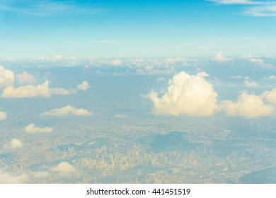 Sky with clouds view from airplane can see mainland of Bangkok, Thailand