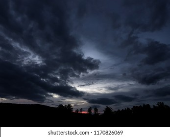 sky and dark cloud, silhouette trees and mountain, sunset background
