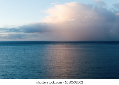 Sky with dramatic clouds on sunset and ocean. Tenerife