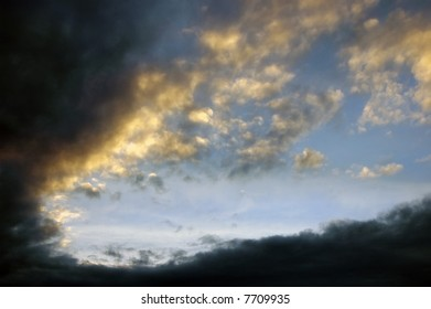 Sky at Dusk with Sun setting behind clouds