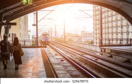 Sky electric train coming to station in morning light for infrastructure urbanista life Bangkok thailand