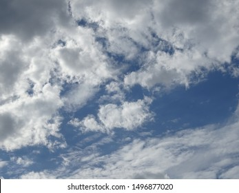 A sky full of cotton ball clouds with the blue sky in the background taken during the spring in the daytime