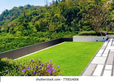 sky garden on rooftop of condominium with blue sky