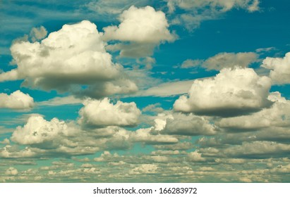 Sky and group of clouds, nature background in retro style