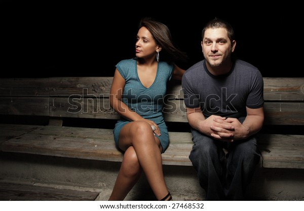 Sky Guy on the bench next to a beautiful young woman