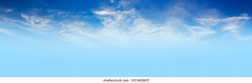 The sky has the light of the sun; the sky is blue; there are small and large clouds alternating and moving slowly; with the sunlight passing; creating a miraculous abstract shape; a hot day