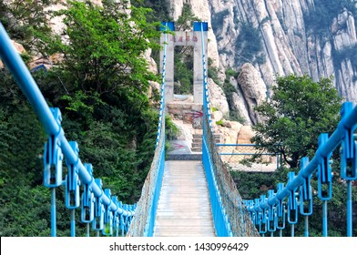 The sky high suspension bridge on the sanhuangzhai plank walk way within the Mount Song scenic area in Henan province. chinese translation is sky high bridge