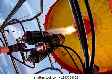 In the sky, inside a hot air baloon.