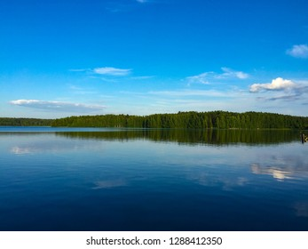 Sky and lake in Karelia - reflection in the water before sunset.