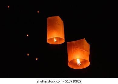 Sky lanterns floating on night of Yi Peng or Loy Krathong festival at Chiangmai, Thailand