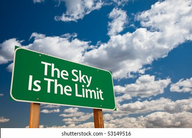 The Sky Is The Limit Green Road Sign with Dramatic Clouds and Sky.