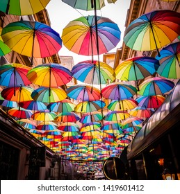 A sky made of colorful umbrellas at the Victoria Passage, a street in Bucharest city centre. Bucharest, Romania