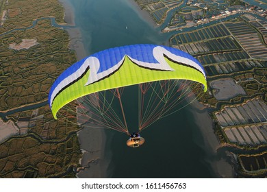 sky man paramotor flying over the salt marshes of Oléron on  Charente-Maritime departement , France