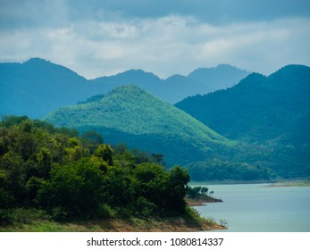 sky mountain forest and reservoir