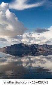 Sky and mountains creating a mirror image in the rain soaked Bonneville Salt Flats in Utah, USA