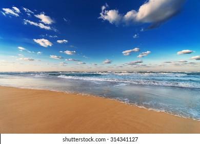 sky, ocean and beach on the sandy beach
