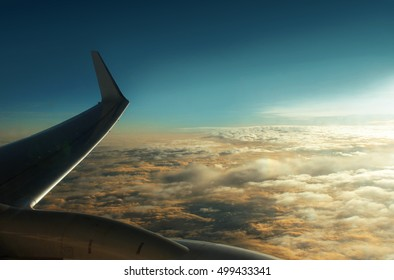 In the sky over the clouds. View from the plane window. Flying a plane