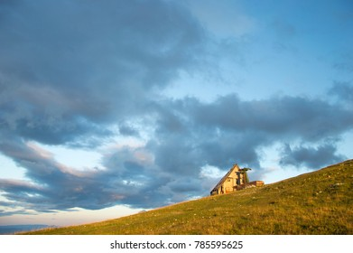 Sky over the old house on top of Velika Planina