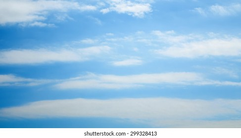Sky panorama for web sites and design. Blue sky and white clouds, soft image.