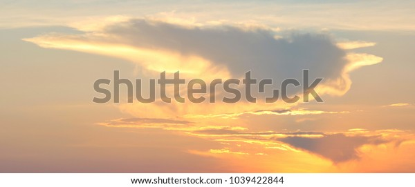 Sky and patterns of clouds in the evening are light orange.