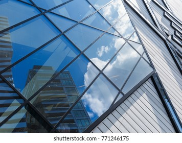 Sky reflected in tower buildings