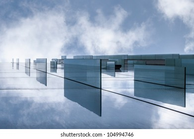 sky reflection in building with glass windows
