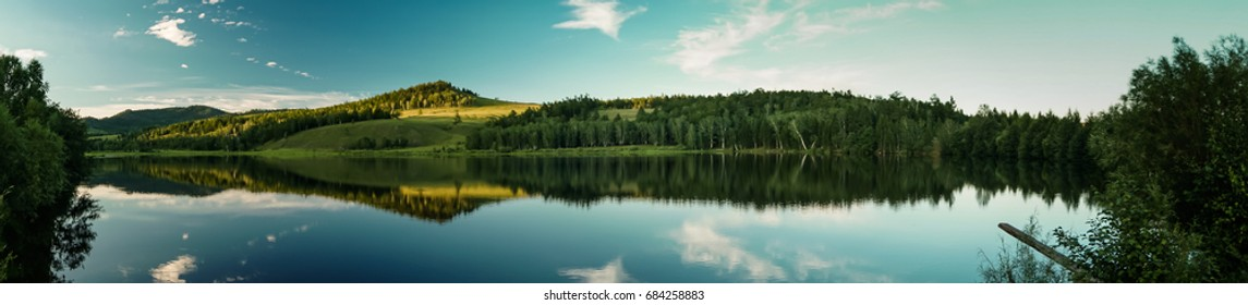 Sky reflection in the calm forest lake