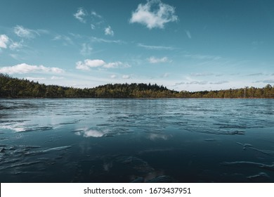 Sky reflection in icy lake
