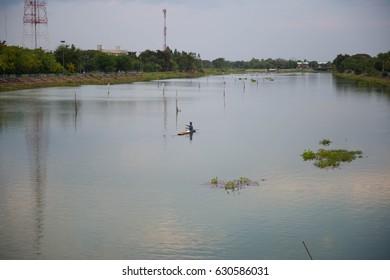 Sky, river, fisherman