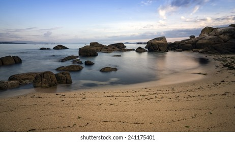 Sky, rocks, sea and sand beach.